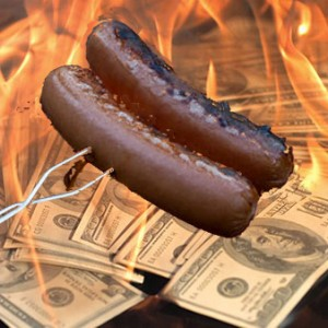 Cooking hotdogs with 100 bills
