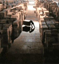 Man putting crate in storage - Raiders of the Lost Ark
