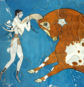 ancient minoan painting of a man holding the horns of a bull