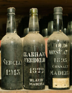 three bottles of madeira wine